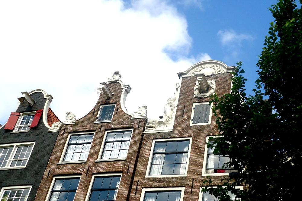 Case tipiche olandesi con la carrucola sulla facciata lungo la Cerchia dei Canali di Amsterdam