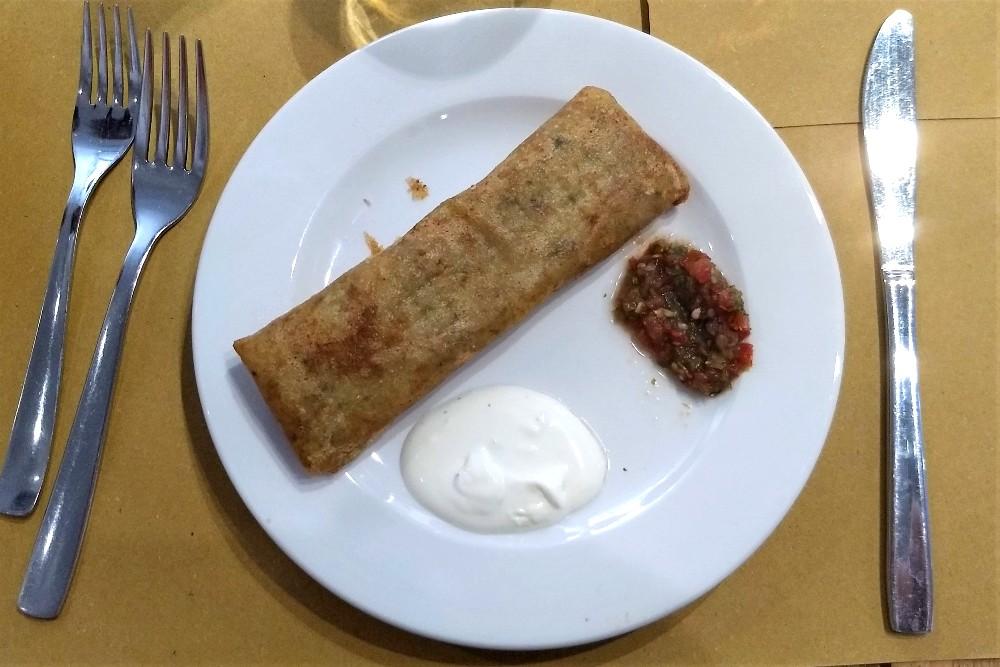 Cucina etnica al ristorante Moltivolti nel quartiere di Ballarò a Palermo, Sicilia